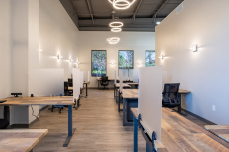 CoWorking Space with Dedicated desks facing windows